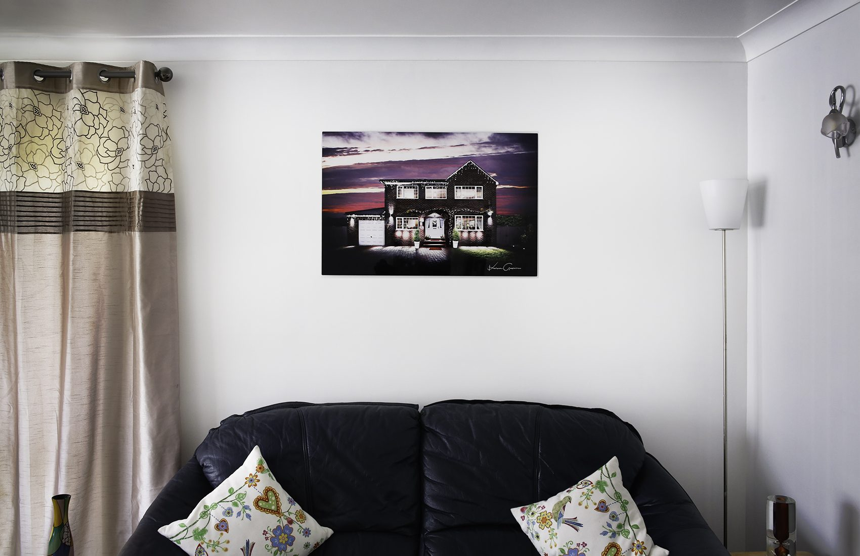 Artwork of a Fine Art Property Photograph metal print on the wall above a sofa