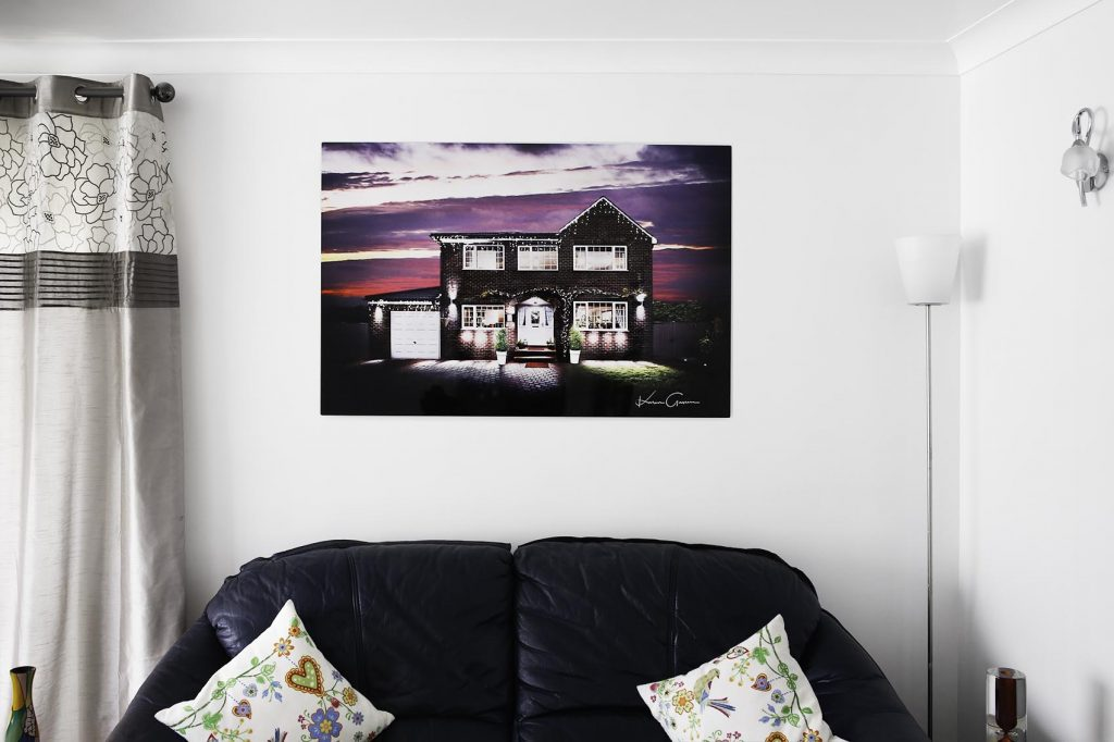 Example of house artwork hung on a wall